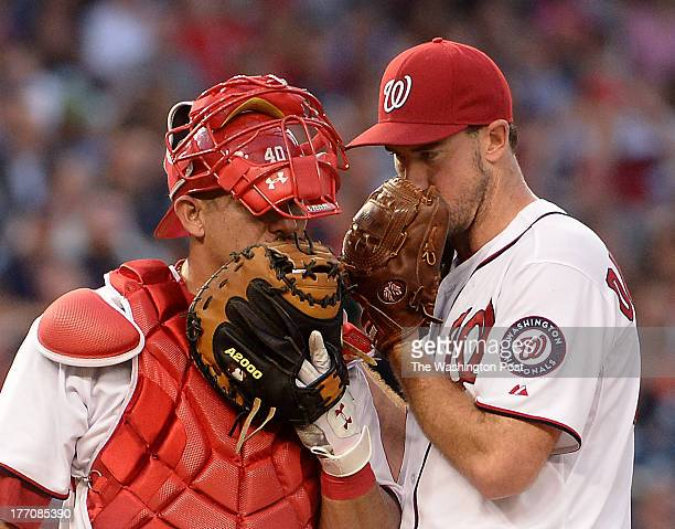 Washington Nationals catcher Wilson Ramos left and Washington Nationals starting pitcher Ross Ohlendorf confer at the mound during the second game...