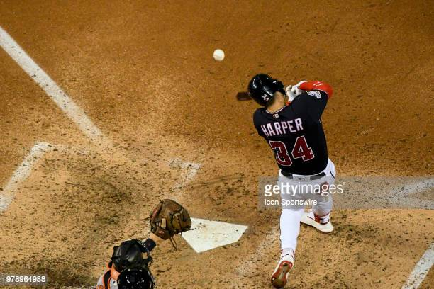 Washington Nationals center fielder Bryce Harper hits an RBI double in the fifth inning during the game between the Baltimore Orioles and the...