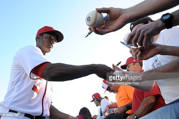 Washington Nationals center fielder Michael A Taylor signs autographs before the game against the Houston Astros March 10 2016 in Viera FL The...