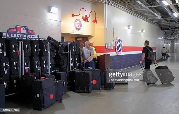 Washington Nationals clubhouse manager Mike Wallace left is ready to take pitcher Drew Storen right personal luggage to add to the stacks of the...