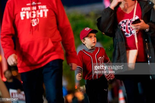 Washington Nationals fans arrive for game four of the 2019 World Series at Nationals Park on October 26, 2019 in Washington, D.C. - The Nationals...