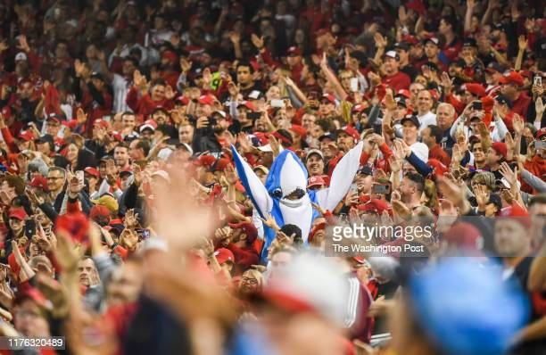 Washington Nationals fans dance to Baby Shark as Washington Nationals center fielder Gerardo Parra comes to the plate in the sixth inning of Game...
