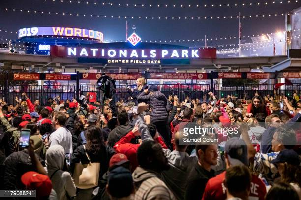 Washington Nationals fans stream into the streets outside of Nationals Park celebrating the Nationals World Series victory on October 30 2019 in...