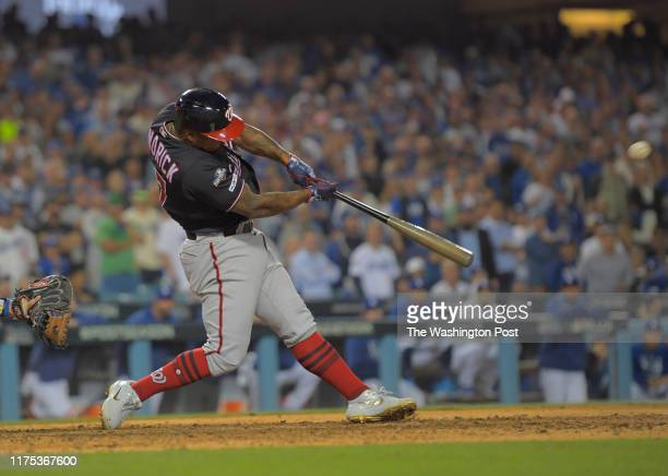 Washington Nationals first baseman Howie Kendrick hits a 10th inning grand slam homer during a game between the Washington Nationals and the Los...