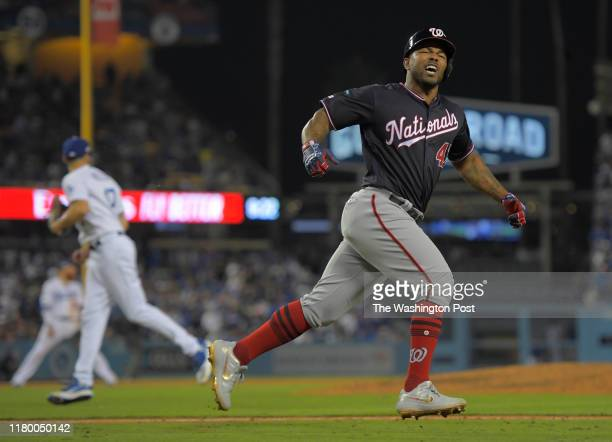 Washington Nationals first baseman Howie Kendrick / yells at the dugout as he runs the bases on a 10th inning grand slam homer during a game between...