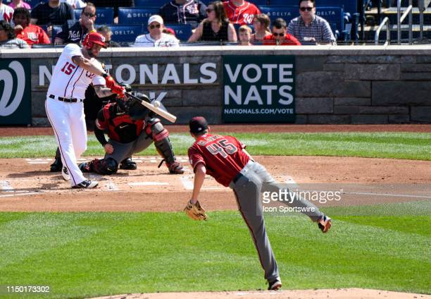 Washington Nationals first baseman Matt Adams hits a solo home run in the first inning against Arizona Diamondbacks starting pitcher Taylor Clarke on...