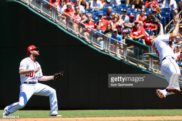 Washington Nationals first baseman Matt Adams leaps to catch a soft line drive as second baseman Daniel Murphy looses the ball in the sun during the...