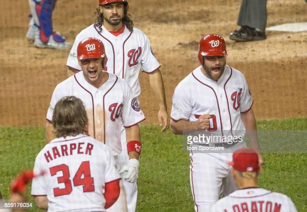 Washington Nationals first baseman Ryan Zimmerman and second baseman Daniel Murphy after Washington Nationals first baseman Ryan Zimmerman had hit a...