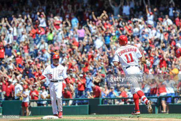 Washington Nationals first baseman Ryan Zimmerman circles the bases after hitting a three run home run in the third inning to become the Nationals...