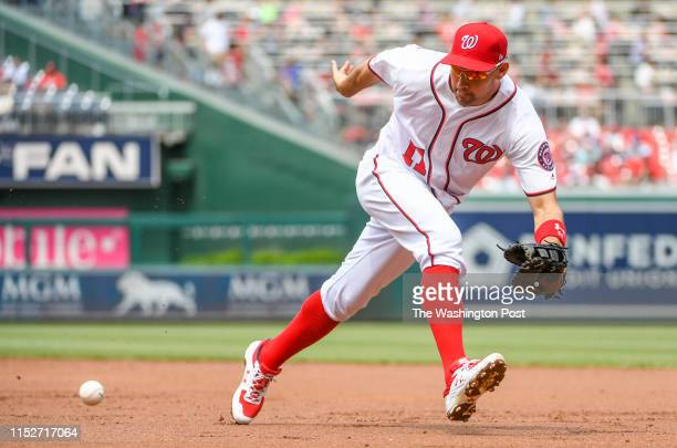 Washington Nationals first baseman Ryan Zimmerman goes to his left to grab a shot down the line by San Francisco Giants catcher Erik Kratz in the...