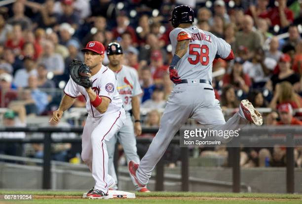 Washington Nationals first baseman Ryan Zimmerman has St Louis Cardinals left fielder Jose Martinez out at first in the eighth inning during a MLB...
