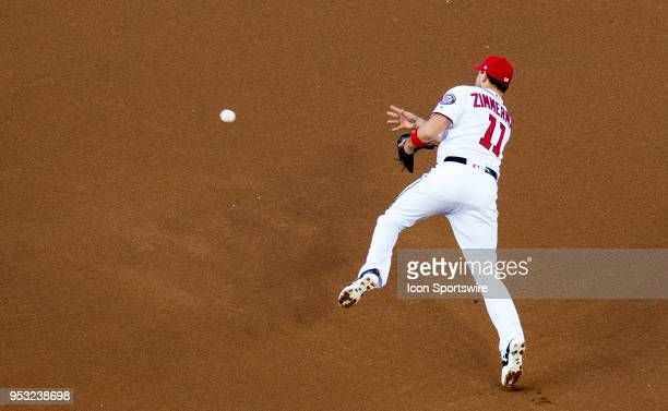 Washington Nationals first baseman Ryan Zimmerman makes an offbalance throw to second on a double play attempt in the second inning during a MLB game...