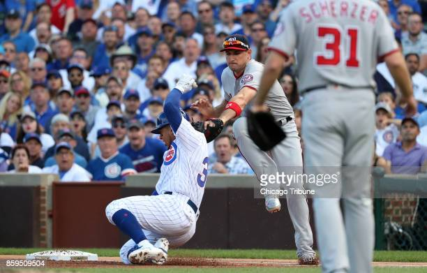 Washington Nationals first baseman Ryan Zimmerman tags out Chicago Cubs center fielder Jon Jay in the first inning Monday Oct 9 2017 in Game 3 of a...