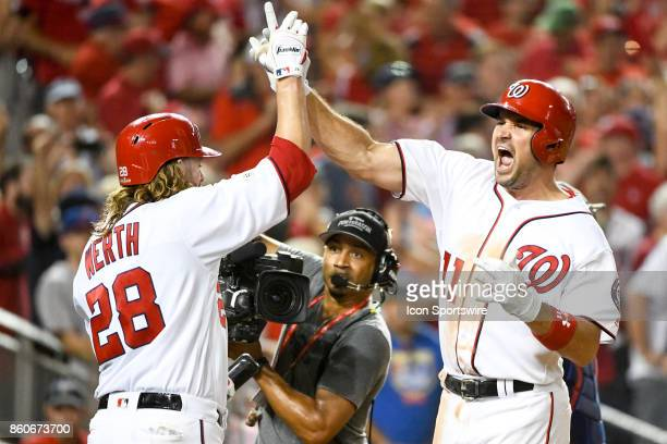 Washington Nationals first baseman Ryan Zimmerman yells out with left fielder Jayson Werth after hitting a game wining 3run home run in the eighth...