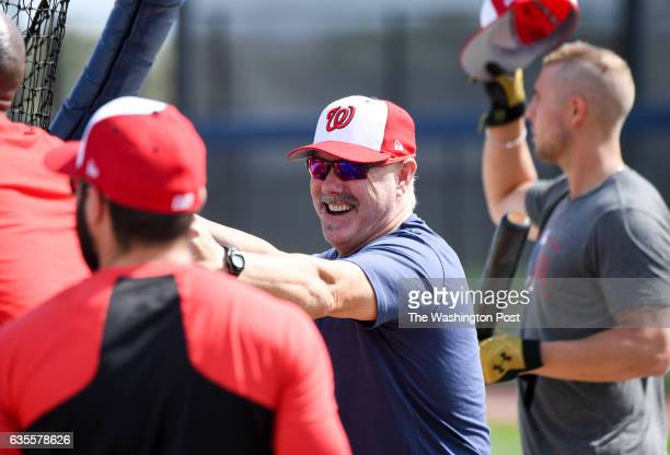 Washington Nationals hitting coach Rick Schu talks with Adam Eaton during batting practice at the Ballpark of the Palm Beaches in West Palm Beach Fl...
