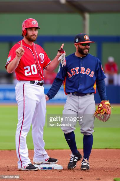 Washington Nationals infielder Daniel Murphy reacts to his standup double as Houston Astros infielder Jose Altuve looks on during a Spring Training...