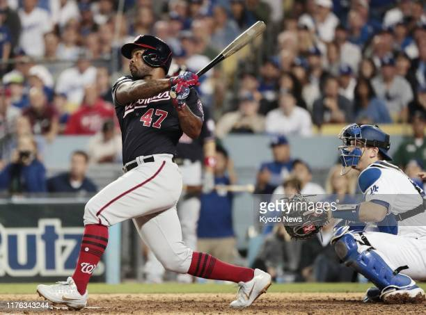 Washington Nationals infielder Howie Kendrick hits a grand slam against the Los Angeles Dodgers in the 10th inning of Game 5 of the National League...