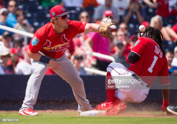 Washington Nationals Infielder Wilmer Difo slides safely into third base before St Louis Cardinals NonRoster Invitee Infielder Patrick Wisdom catches...