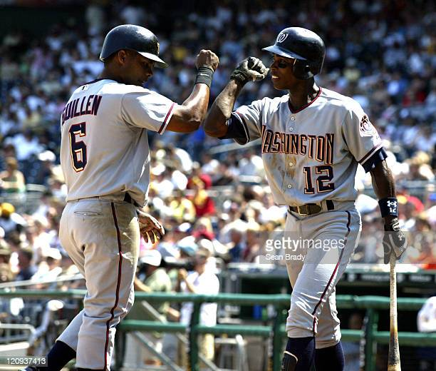Washington Nationals Jose Guillen knocks elbows with teammate Alfonso Soriano after crossing the plate for a run against Pittsburgh at PNC Park in...