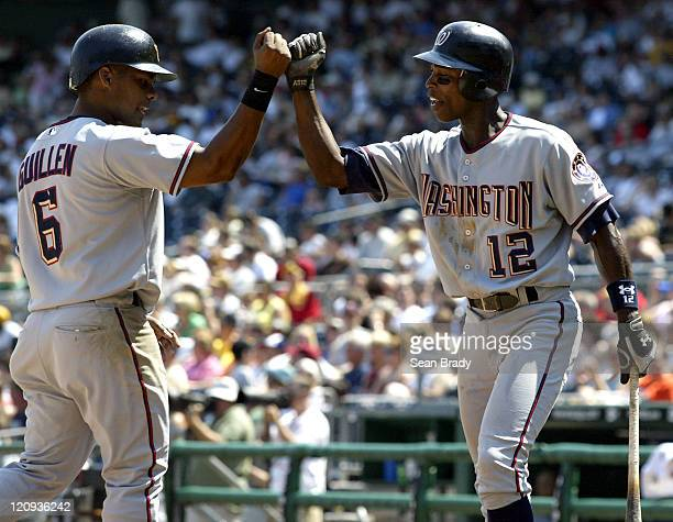 Washington Nationals Jose Guillen knocks fists with teammate Alfonso Soriano after crossing the plate for a run against Pittsburgh at PNC Park in...