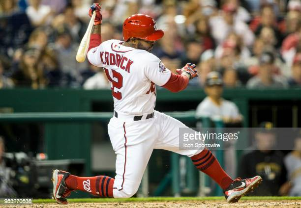 Washington Nationals left fielder Howie Kendrick loses his balance after a fierce swing during a MLB game between the Washington Nationals and the...