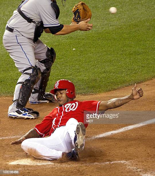 Washington Nationals left fielder Willie Harris scores the game-winning score on a sacrafice fly by Ryan Zimmerman against the New York Mets during...