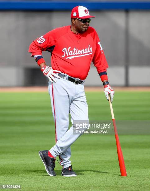 Washington Nationals manager Dusty Baker keeps an eye on his squad during the first workout of position players at the Ballpark of the Palm Beaches...