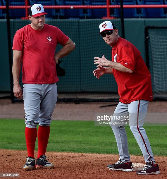 Washington Nationals manager Matt Williams right works with Washington Nationals left fielder Ryan Zimmerman left on the fundamentals of playing...