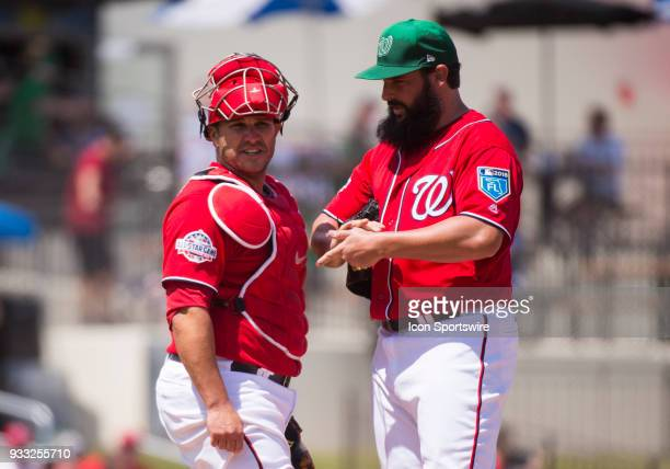 Washington Nationals NonRoster Invitee Catcher Miguel Montero and Washington Nationals Pitcher Tanner Roark talk on the mound during the St Patrick's...