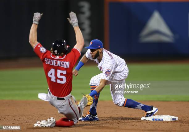Washington Nationals Outfielder Andrew Stevenson is out on a force out played by New York Mets Infielder Amed Rosario during the third inning of the...