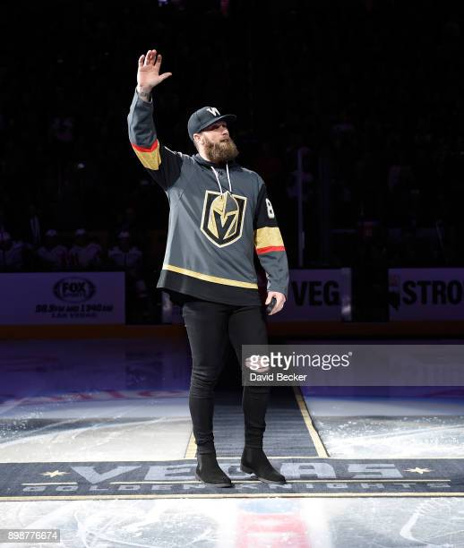 Washington Nationals outfielder Bryce Harper waves to the crowd before dropping the ceremonial puck before a game between the Washington Capitals and...