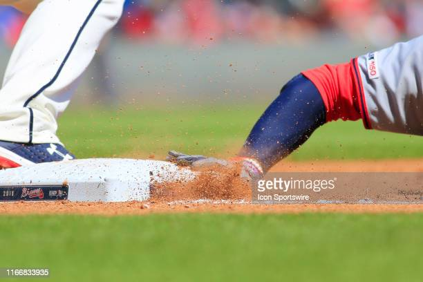 Washington Nationals Outfielder Juan Soto slides safely back to first base on a pick off attempt during the MLB game between the Atlanta Braves and...