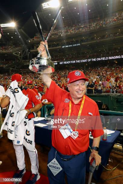 Washington Nationals owner Mark Lerner poses with the home run derby trophy after Bryce Harper of the Washington Nationals won the TMobile Home Run...