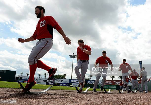 Washington Nationals pitcher Danny Rosenbaum leads the way in an agility drill during spring training workouts on February 24 2014 in Viera Fl