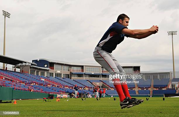 Washington Nationals pitcher Joh Lannan does a standing broad jump as part of a conditioning dril during Spring Training in Viera FL on Wednesday...