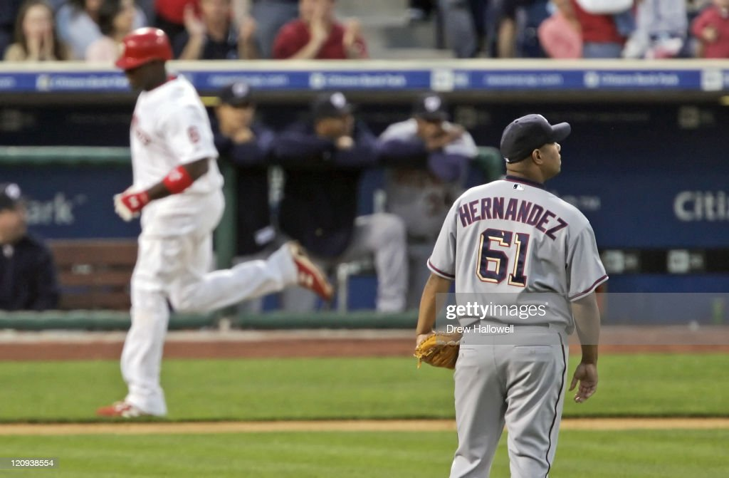 Washington Nationals pitcher Livan Hernandez (61) looks to the score board after Ryan Howard (6) hit a home run Wednesday, April, 19, 2006 at Citizens Bank Park in Philadelphia, PA. The Philadelphia Phillies defeated the Washington Nationals 7-6 in extra innings.