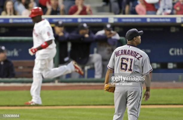 Washington Nationals pitcher Livan Hernandez looks to the score board after Ryan Howard hit a home run Wednesday, April 2006 at Citizens Bank Park in...