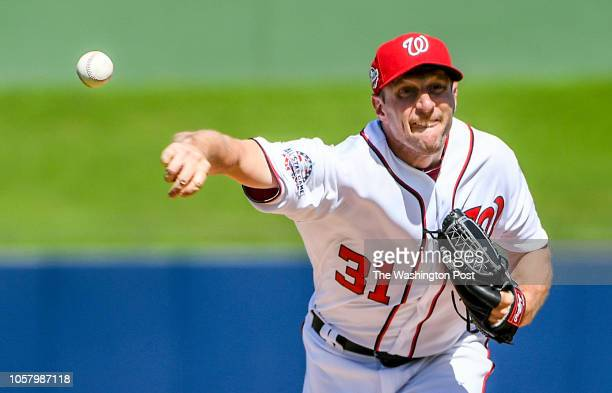 Washington Nationals pitcher Max Scherzer pitches against the Atlanta Braves during spring training action at The Ball Park of the Palm Beaches