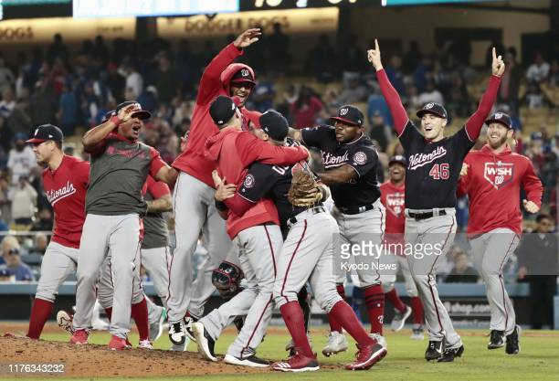 Washington Nationals players celebrate after beating the Los Angeles Dodgers in Game 5 of the National League Division Series in Los Angeles on Oct 9...