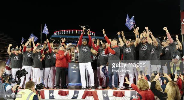 Washington Nationals players celebrate after beating the St Louis Cardinals in Game 4 of the National League Championship Series in Washington on Oct...