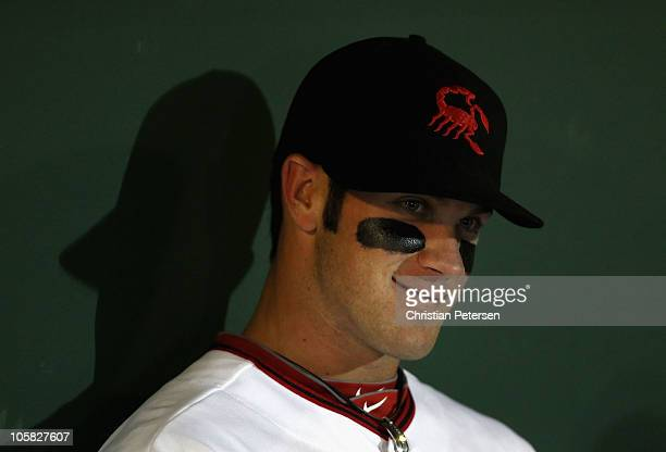 Washington Nationals prospect Bryce Harper playing for the Scottsdale Scorpions sits in the dugout during the AZ Fall League game against the Mesa...