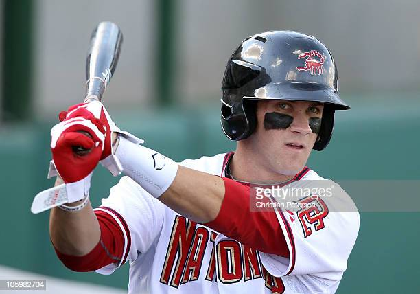 Washington Nationals prospect Bryce Harper playing for the Scottsdale Scorpions warms up on deck during the AZ Fall League game against the Phoenix...