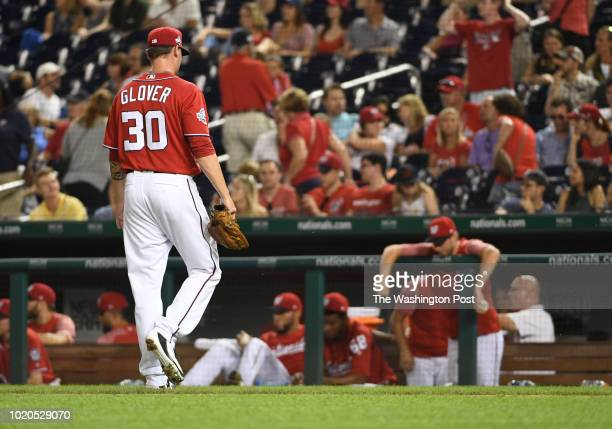 Washington Nationals relief pitcher Koda Glover walks off the mound after giving up two runs to the Miami Marlins in the tenth inning to take the 75...
