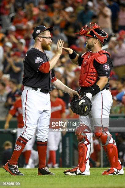 Washington Nationals relief pitcher Sean Doolittle is congratulated by catcher Spencer Kieboom after his ninth inning save during the game between...