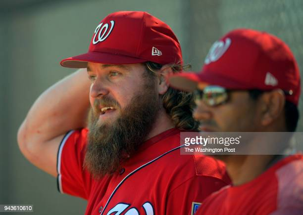 Washington Nationals relief pitcher Shawn Kelley left converses with manager Dave Martinez as the Washington Nationals pitchers and catchers...