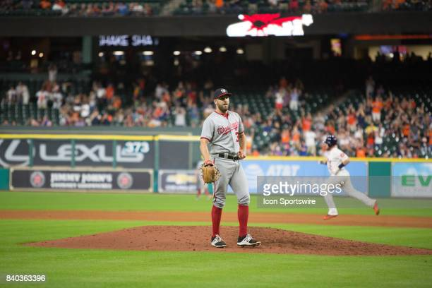 Washington Nationals relief pitcher Shawn Kelley steps off the mound as Houston Astros third baseman JD Davis runs the bases in the eighth inning of...