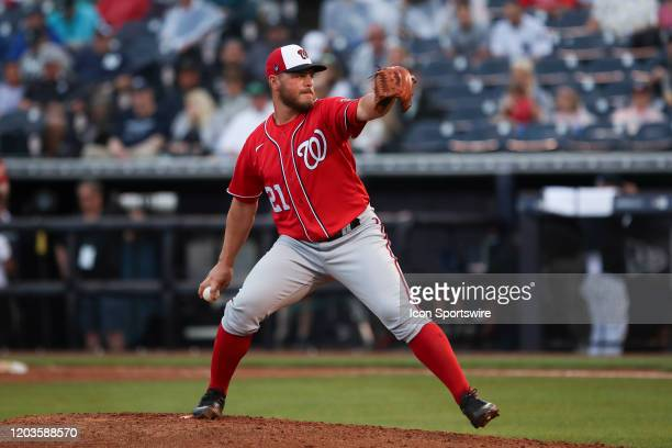 Washington Nationals relief pitcher Tanner Rainey delivers a pitch during the MLB Spring Training game between the Washington Nationals and New York...