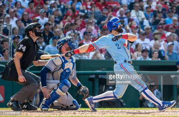Washington Nationals right fielder Adam Eaton checks the trajectory of his hit during a MLB game between the Washington Nationals and the Kansas City...