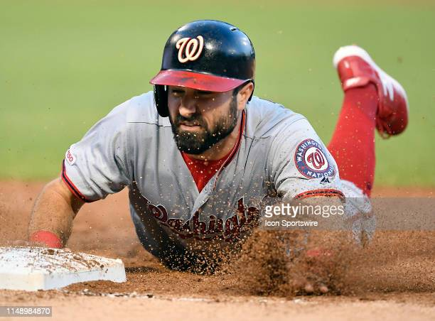 Washington Nationals right fielder Adam Eaton dives back to first base in the third inning against the Chicago White Sox on June 10, 2019 at...