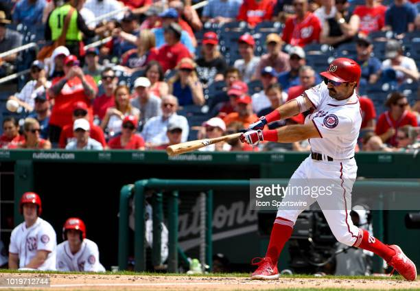 Washington Nationals right fielder Adam Eaton hits a double in the third inning during the game between the Miami Marlins and the Washington...